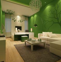 wohnzimmer einrichten ideen grüne wände schöne wanddeko beiger teppich