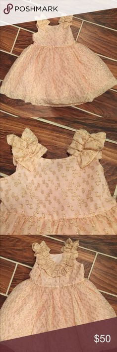 Janie and Jack 12-18 months Pink and Gold Dress This gorgeous dress is a fit for any little princess. The sparkle on the dress is gorgeous. My daughter wore it once for her first pink and gold princess birthday party. Needs a new loving home. Janie and Jack Dresses Formal
