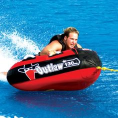 "Outlaw | Airhead Watersports  WANTED! REBEL with a CAUSE on this 48"" inch, Triangular, 1 person capacity, partially covered tube. Equipped with heavy-duty foam handles intended to increase your comfort on this wild ride!"
