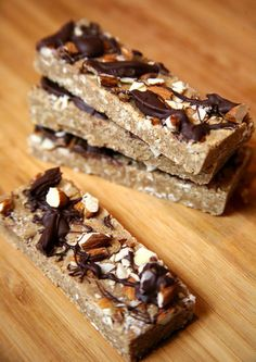 "Gotta try these! Made with just a handful of ingredients, you can whip up these chocolate almond protein bars in less than 20 minutes. Even better, they're lower in calories and higher in protein and fiber than the average ""healthy"" sweet bar bought at the grocery store. Total protein (per bar): 12.8 grams Photo: Jenny Sugar"