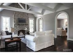 Espresso Floors, white beamed ceilings.