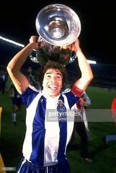 Portrait of Manuel Joao Pinto of FC do Porto holding the trophy aloft after the European Cup final against Bayern Munich at Prater in Vienna Austria...