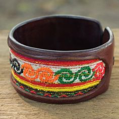 Leather cuff with bright colorful tribal detail. @Etsy