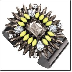 Avon...mark. COLOR POP CUFF • Watch admirers flock to you whenever you wear this fantastic feather design  • Neon-yellow, smoky and clear faceted faux stones on hematite-colored metal. ORDER HERE: www.youravon.com/mhamilton39