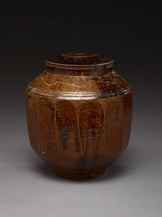 Covered jar with faceted sides, stone and iron, 19th century Korea. This kind of pottery was not respected in it's time, and was mostly left for the lower class. The craftsmanship was noticed later by 20th century Japanese artists, who brought them back into style  #Koreanart #Pottery #Crowcollection