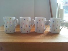 Raindrop mugs, hand painted with porcelain pens.