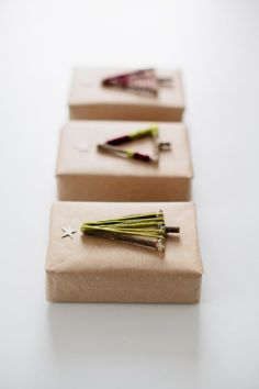 kraft paper Christmas wrap + stick & yarn trees