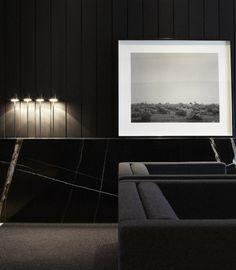 I love this minimal room with its black paneling & black & white art. Gorgeous, sophisticated & elegant.....V