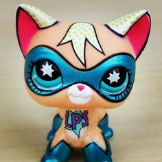 I think This is a custom cat also from GOGREENGIRL on youtube :) also this lps is one ebay.com and keychain of this lps on etsy.com