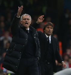 Manager Jose Mourinho of Manchester United and Manager Antonio Conte of Chelsea watch from the touchline during the Premier League match between...