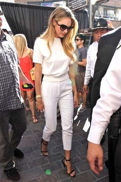 Short sleeve, white knit top. Slim white cropped pants. Black strappy heels
