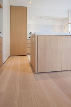 In a kitchen you can use two different kinds of floors. Here they use a wooden floor in combination with a natural floor around the kitchen island. Collection: New York Pure Parquet Flooring, Wooden Flooring, Laminate Flooring, Natural Flooring, Interior Architecture, Interior Design, Scandinavian Home, Future House, Natural Stones