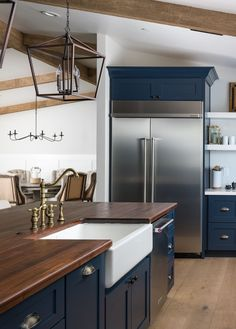 Navy cabinets with butcher block counter, farmhouse sink and brass faucet. and stunning midnight blue cabinets. Kitchen Design Open, Kitchen Cabinet Design, Kitchen Redo, New Kitchen, Kitchen Remodel, Kitchen With Farmhouse Sink, Maple Kitchen, Open Concept Kitchen, Navy Blue Kitchen Cabinets