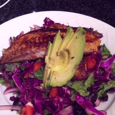 Blackened talapia over mixed greens/red pepper/cabbage slaw with lime cilantro dressing.