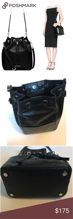 """Michael • Kors • Bucket • Handbag Authentic MK black leather """"Dottie"""" style bucket handbag.  🔶Exterior • Features shiny rhodium tone hardware, 1 back slip pocket, drawstring and magnetic closure, with 11' L single strap and a 19.75'-22' adjustable strap attachment, never used and still wrapped.  🔶Interior • Features MK signature lining, 1 zip pocket, 2 slip pockets and key clip.  🔶Measures • 12' W x 11' H x 5.25' D.  🔶Condition • Handbag is in beautiful like new condition, carried twice…"""