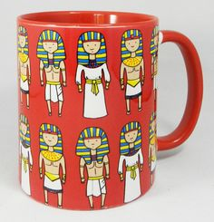 The Egyptian Pharoah Mug with red glazed inner and handle. Lines of happy Egyptian Pharoahs in various outfits. Designed and printed in Britain. A high quality ceramic mug which is dishwasher proof. Height is 9cm, diameter 7.5cm, with a capacity of 270 ml (9oz). From the Series 1 Original Line Range from Half a Donkey www.halfadonkey.co.uk