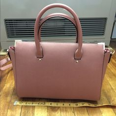 NWOT Dusty mauve/rose bag Never used. Dimensions: L-13 1/4in.   H-10in.  D-4 1/8in. Primark Bags