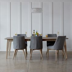 The Abbey Chair defines understated chic with its elegant contoured seat and back. Available in a choice of subtle washed grey, Oak and stained Walnut wooden legs.