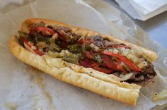 Philip's Old Fashioned Cheesesteak  The Old Fashioned is a steak with provolone, grilled tomato, fried onions, pepper, salt, oregano and Italian peppers.