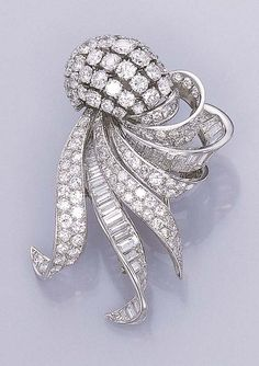 A DIAMOND CLIP BROOCH, BY MARC   Designed as a series of pavé-set and baguette-cut diamond ribbons gathered by a circular-cut diamond cluster, circa 1955, with French assay marks  Signed Marc, Paris, no. 299