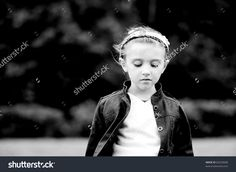 Black and white outdoors portrait of thoughtful child girl