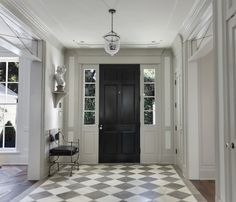 Stunning entry. Beautiful 'greige' limestone and white marble chequerboard floor.