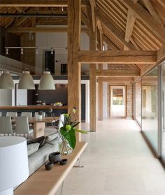 Interior of an old barn, converted into a home with a contemporary feel, retains its original oak wood beams  (via Viahouse.Com)