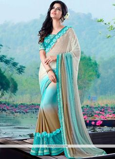 This eye catching elegant drape is perfect for any occasion. Outstanding craftmanship of embellishments exhibited in this blue faux chiffon and net classic designer saree. The brilliant attire creates...