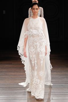 Naeem Khan's spring 2017 bridal collection includes gowns, long-sleeve wedding dresses, and beautiful colors like pale pink and black (there's even a wedding dress with flowers!). Click to see them all.