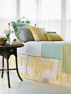 I love the color combo of sea green, teal, lemon yellow, and navy blue.....  Living room