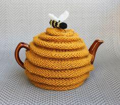 (via Ravelry: frazzledknitter's Beehive Tea Cozy)