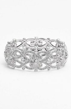"Details & CareAn intricately cut bangle shimmers with hand-set crystals for a radiant, handcrafted piece.7"" inner circumference; 1"" width. Sold individually. Tongue-and-groove cl..."