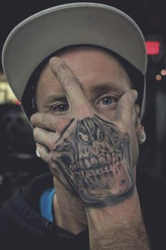 Cool Skull Tattoo on Hand for Men