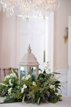 white lanterns, floral wreath- maybe less intense wreath to keep it simple