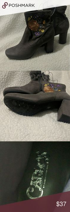 Carlos by Carlos Santana Boots with embroidered 🌹 Beautiful gray boots with embroidered flowers / rose on the side. Rose pattern on the bottom. NWOT new and never worn. Carlos Santana Shoes Ankle Boots & Booties