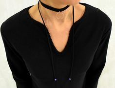 A circle choker necklace on black suede with a sterling silver 925 circle. This charm choker necklace is adjustable and can be worn as a wrap or as a tie. A chic piece of jewelry and lovely gift.  Also comes with yellow gold circle on black suede, view here: http://etsy.me/2eOTNHE Can view our store here: http://etsy.me/2grDjq9  .......Materials used: Cord = suede Pendant = sterling silver 925 Beads = ceramic  .......Length/Size: (If you would...