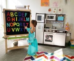 Princess Jasmine learning the alphabet in Spanish at 26 months! We love this easel from for its many uses. Felt board, magnetic dry erase board with paper roll holder and chalk board in one. Paper Roll Holders, Art Easel, Bilingual Education, Preschool At Home, Learning The Alphabet, Princess Jasmine, Dry Erase Board, Toddler Activities, Growing Up