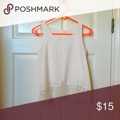 Tank top White tank top with lace, it falls just at your waist where the lace scrapes the top of your jeans. Tops