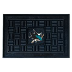 """San Jose Sharks Medallion Door Mat - Wow your guests with door mats by FANMATS. Adorned with your favorite team's logo, these door mats make a statement while keeping dirt and mud from entering your home. Heavy duty vinyl construction ensures a durable mat. Deep reservoir contains water and debris. Rugged ribs scrape shoes clean. Your favorite team's logo is molded in 3D construction.FANMATS Series: DOORMATTeam Series: NHL - San Jose SharksProduct Dimensions: 19.5""""x31.25""""Shipping Dimensions…"""
