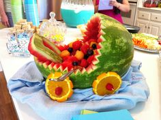 It's a baby carriage made from a watermelon. Perfect for a spring shower.