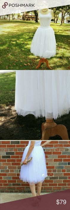 "SNOW WHITE Tulle Skirt Handmade, soft tulle skirt with elastic, flat waist band  perfect for everyday wear. Comfort and style.  No itchy skirts here!   - 4 layers of high density tulle  - Tea length 26"" inches - Flat stretchy waistband - Handmade  SMALL will fit approx US sz 0-6, waist 24""-32"". MEDIUM will fit approx US sz 8-14, waist 32""-39"".  Model in 3rd photo is 5'8"". Gorgeous must-have for always! C'est Ca New York  Skirts"