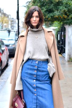 A balanced combination of camel coat, denim skirt, turtle neck sweater and minimal jewelry