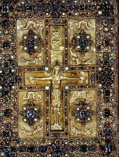 The Magnificent Upper Cover of the Lindau Gospels (Circa 875). The Lindau Gospels, was written and illuminated in the Abbey of St. Gall, Switzerland, possibly by the scribe, Folchard, who also may have been the artist. It contains four title and four incipit pages in gold on vellum stained purple, twelve canon tables on purple backgrounds, lettered in gold and silver, 2 carpet pages. St Gall was founded by the Irish monk St Gallen and contains manuscripts in early Gaelic script.