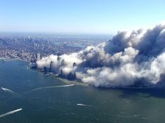 - Aerial view of smoke pouring from New York City's decimated Financial District in Lower Manhattan, the former site of the World Trade Center's Twin Towers, at around midday on September We Will Never Forget, Lest We Forget, World Trade Center, Trade Centre, 911 Twin Towers, 11 September 2001, Historia Universal, Sneak Attack, Bodies