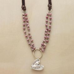 LOVE COMES AROUND NECKLACE - I am not a heart person,  but I love the primative look of this one.