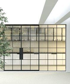 Elegant kitchen with black frame windows & doors
