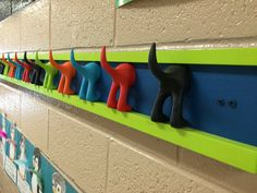 Cute customizable puppy tail coat rack for kids. Perfect for classrooms!