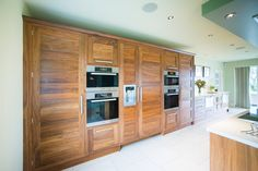 A stunning bank of cupboards house the various ovens