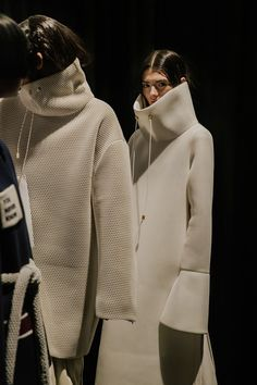 Sculptural white funnel coats at VFiles: Andrea Jiapei Li AW15 NYFW. See more here: http://www.dazeddigital.com/fashion/article/23592/1/vfiles-made-aw15