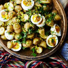 Egg salad and potato salad: Unite! We like how the still-soft yolks dress the salad, but you can cook the eggs a minute or two longer if you like them more set.
